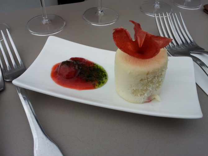 Dessert of strawberry filling cheese cake with mint jelly