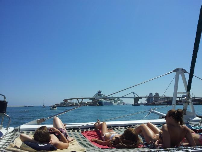 Sun-seekers on the catamaran